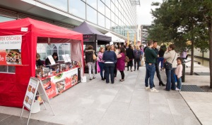 Visitors lining up to sample street food by Eastside Park